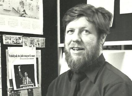 Reardon at Tribune desk in 1980s